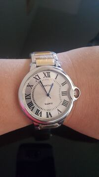 silver-colored Cartier analog watch with link bracelet