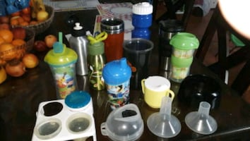 Variety of plastic and metal drinking containers