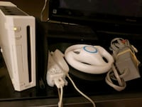 white Nintendo Wii with controllers Cocoa, 32927
