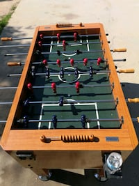 brown and green foosball table Lockport, R1A 2S3