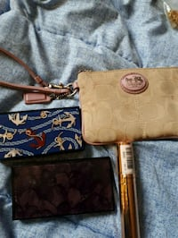 brown and black monogram Coach leather wristlet St. Catharines, L2M 4G1