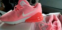 pair of red Nike basketball shoes Charlotte, 28211