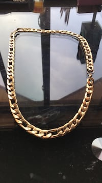 gold-colored chain necklace