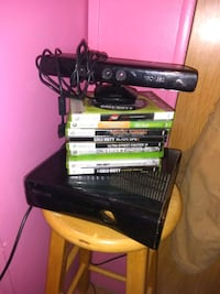 black Xbox 360 console with game cases Bellevue, 68005