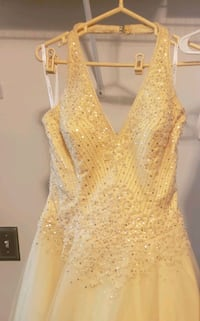 Pale yellow halter formal with sequins, full skirt. Worn once.