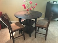 """Counter height (36"""") table + 2 chairs. The table is 42"""" diameter Ashburn, 20147"""