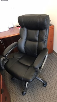 black leather office rolling armchair Oakland, 94612