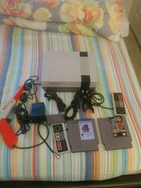 NES console with controller and game cartridges Lombard, 60148