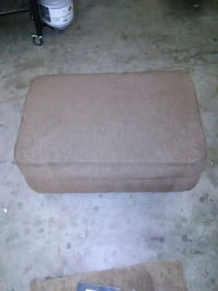 brown fabric padded ottoman chair