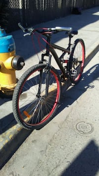 black and red duel suspension mountain bike Kelowna, V1W