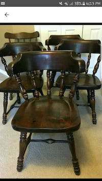 3 brown wood chairs