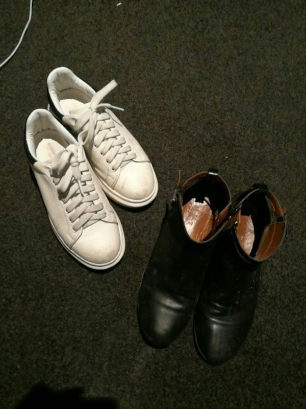 white lace-up low-top sneakers; black leather side-zip boots