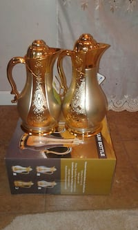 tow brass pitchers with box