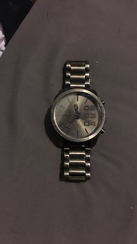 Round silver Diesel chronograph watch with link band