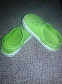 pair of green rubber clogs