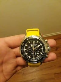round silver Nautica chronograph watch with yellow