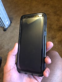 Black samsung galaxy s8 with some included cases Clayton, 19938