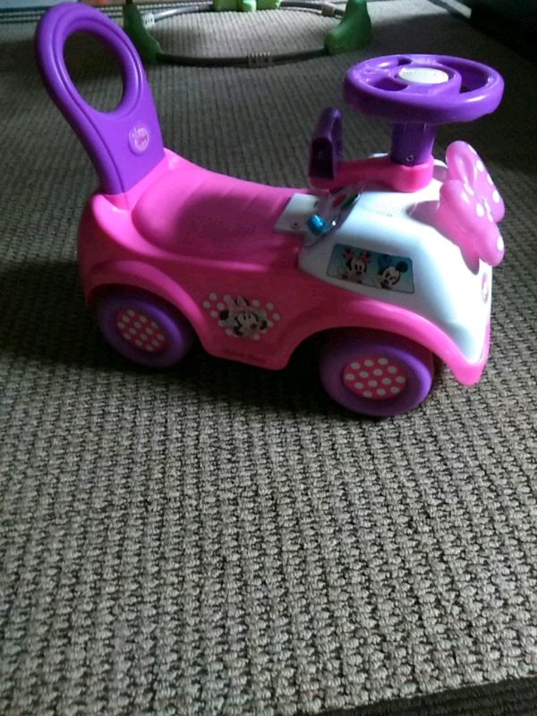 pink and purple ride on toy