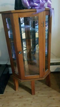 brown wooden framed glass display cabinet Edmonton, T5E 0P7