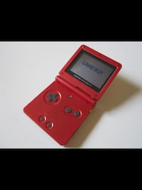 red Nintendo DS with game cartridge Edmonton, T5L 0S3