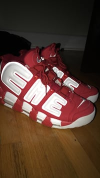 pair of red-and-white Nike basketball shoes Kirkland, H9R 2Y6