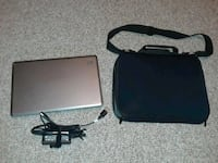 gray HP laptop with black AC adapter and black lap Foley, 56329