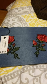 blue and red floral textile