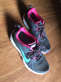 Gray-and-pink Nike running shoes Las Vegas, 89103