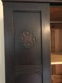 Armoire with built in shelves