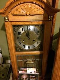 Brown wooden pendulum clock chimes ever hour