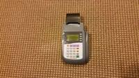 gray credit card terminal w tapes