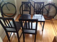 Four black wooden framed chairs Vancouver, V6E 4A2