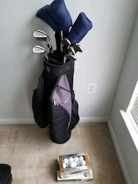 Golf clubs with caddy and balls Centreville