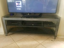 TV stand, steel frame with glass shelves. Will hold 70+ inch TV.