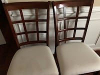 4 cherry wood  ivory padded cushion chairs 55 km