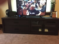 """Entertainment center purchased from Walmart 1 yr ago. No damage. 2 drawers, 2 shelves inside glass doors, 72""""x21"""". Pick up only. Akron, 44312"""