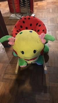 Pink and green animal plush toy