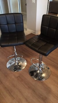 two black leather padded bar stools 538 km