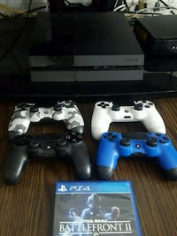 Sony PS4 console with four controllers