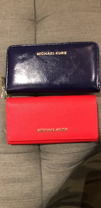 Limited edition Micheal Kors midnight blue and cherry red limited edition wallets. 2 for $100 Brampton, L7A 3S4