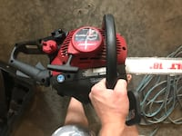 red and black Troy-Bilt gas chainsaw Calgary, T2K 0C7