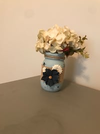 white petaled orchid and blue mason jar