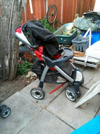 baby's red and black stroller Calgary, T3J