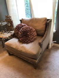 brown fabric padded sofa chair