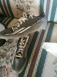 pair of gray-and-white Adidas running shoes Des Moines