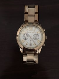 round silver chronograph watch with link bracelet Toronto, M3H 1H9