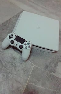 white Sony PS4 console with controller Houston, 77077