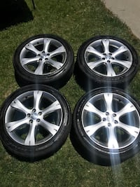 P205/50R17 dunlop tires with silver aluminum wheels