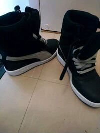 pair of black-and-white Nike sneakers Toronto, M6H
