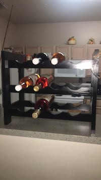 black wooden wine rack